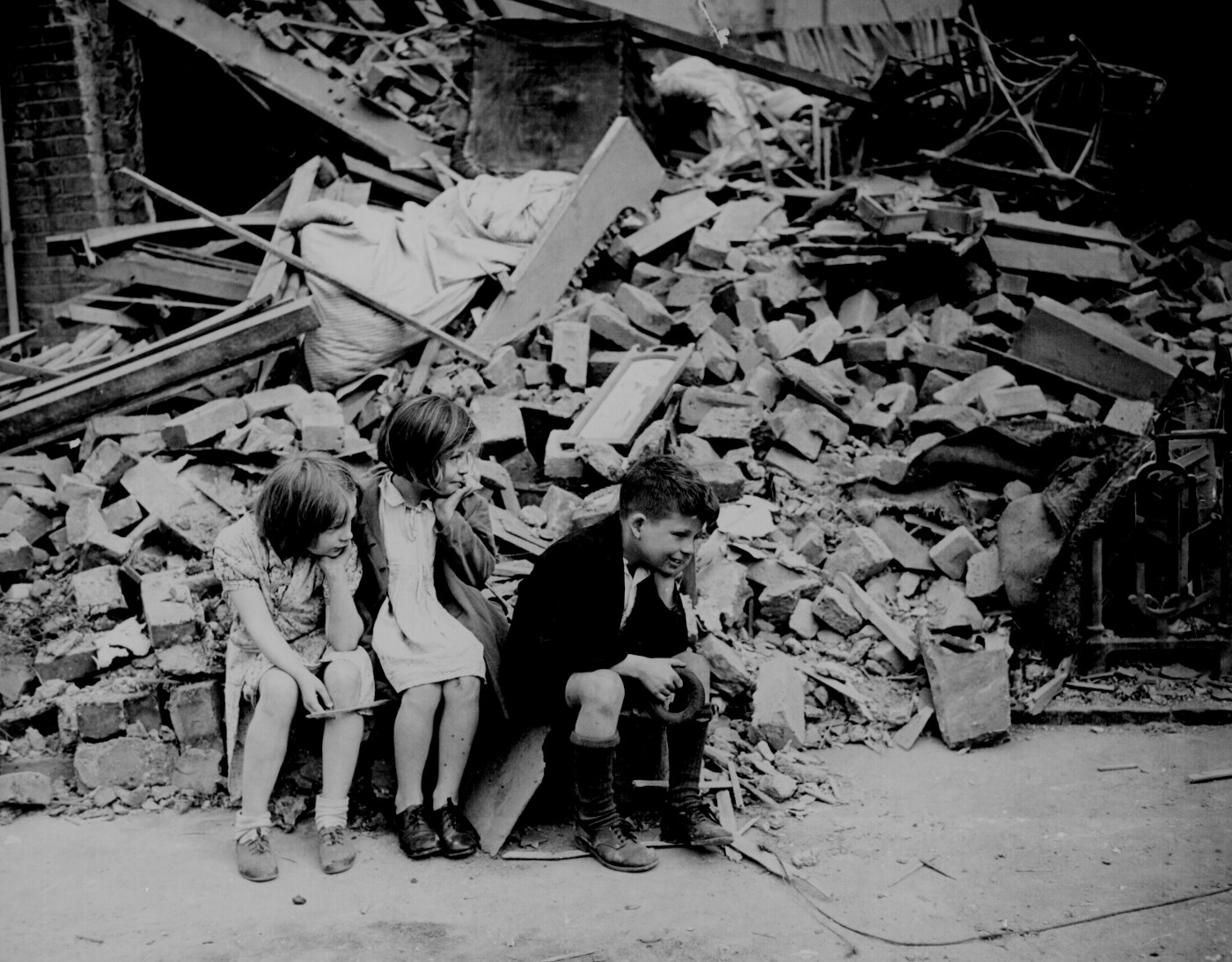 Children in an Eastern suburb of London whose home has been bombed.  Sept 1940