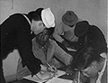 Filling out forms for enlistment in the Navy, ca. 1940, National Archives Identifier: 285826