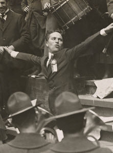 "Charlie Chaplin, movie star, leading the band at the Public Library, New York City, to spread the ""Buy Liberty Bonds"" slogan"