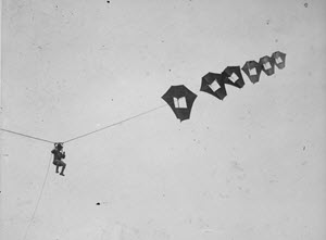 Lieutenant Kirk Booth of the U.S. Signal Corps being lifted skyward by the giant Perkins man-carrying kite at Camp Devens, Ayer, Massachusetts