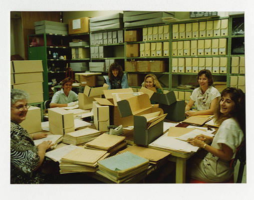 Staff and volunteers processing archival collections [NAID 29011076]