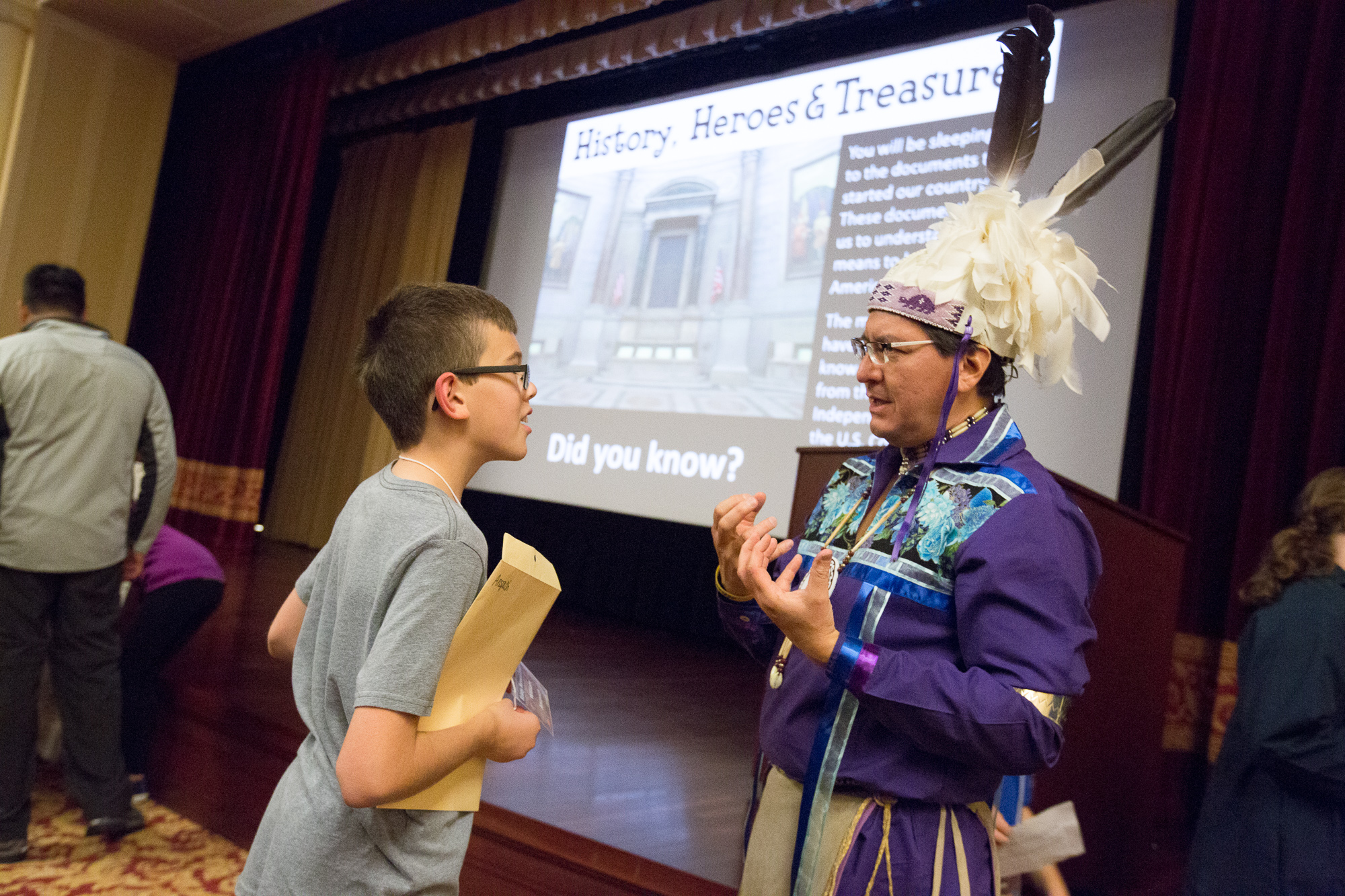 3d4a0f4ea Native American storyteller Perry Ground chats with a guest after his  storytelling presentation. (Photograph by Jeffrey Reed, National Archives)