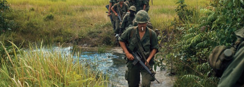 Members of Company B, 1st Battalion, 27th Infantry Regiment (Wolfhounds), 25th Infantry Division, cross a stream approximately 9.3 miles southeast of Nui Ba Den, Vietnam