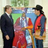 President Reagan receiving a Native American painting from John Nieto in the Oval Office, 1982