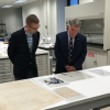 Archivist of the United States David S. Ferriero and Potawatomi Nation Tribal Councilman Alex Warsaw look at Indian Treaties in the conservation lab of the National Archives Building in Washington, DC. Image by Jennifer Miller for NMAI.