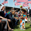 President Barack Obama, with First Lady Michelle Obama, greets a young boy during the Cannon Ball Flag Day Celebration during a visit to the Standing Rock Sioux Tribe Reservation, Cannon Ball, ND, 2014. Courtesy Barack Obama Presidential Library.