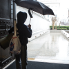 A sleepover participant—armed with his overnight gear, a goody bad, and an umbrella—prepares to head home after the National Archives Sleepover held February 24-25, 2018, in Washington, D.C. (National Archives photo, Jeff Reed)