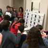 "National Archives Sleepover participants gather around ""Mission Control"" as they complete their first challenge activity of the evening—collecting and matching astronaut trading cards—at the National Archives Sleepover on February 24-25, 2018"