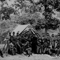 5. Engineers of the 8th New York State Militia in front of a tent, 1861.