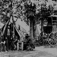 20. A New York Herald Tribune wagon and reporters in the field.