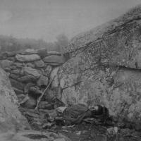98. Dead Confederate sharpshooter in the Devil's Den, Gettysburg, Pa., July 1863.
