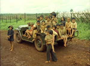 Photograph of Children Sitting in a Special Forces Jeep