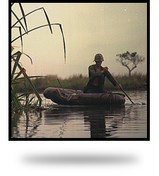 Vietnam. Private First Class David Sletten, medic, Company B, !st Battalion, 27th Infantry, 25th Infantry Division, paddles a three-man assault boat down the canal toward a breaking point during Operation Tong Thang I.